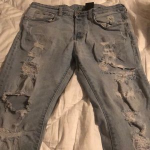 H&M ripped blue jeans